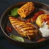 Стейк з курячого філе, з нотками каррі, печеною картоплею, кукурудзою гриль і соусом барбекю Grill Pub