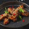Курячі крильця в тайському соусі з кунжутом Grill Pub
